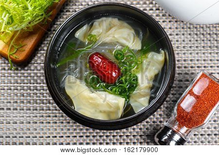 Korean soup with Apple in black pot