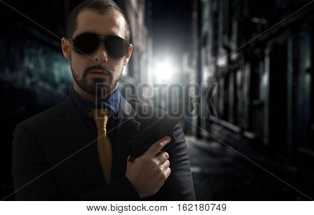 Portrait of a crook in a dark ghetto street
