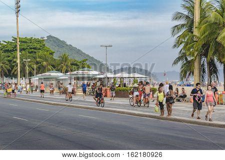RIO DE JANEIRO, BRAZIL, JANUARY - 2016 - People walking at Copacabana sidewalk promenade in Rio de Janeiro Brazil