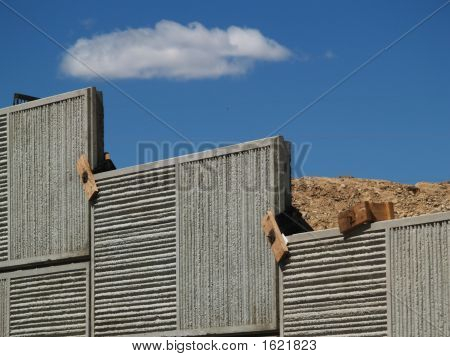 Constuction Wall With Dirt And Blue Sky Cloud