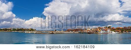 Nesebar Bulgaria - September 06 2013: Ships boats and yachts in the port of the old town Nessebar on the bulgarian Black Sea coast. UNESCO world heritage site. Panoramic shot.