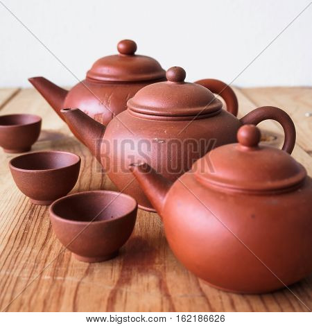 Chinese teapot and teacup on wood table