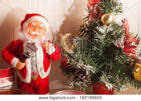 Toy Santa Claus and Christmas tree, merry Christmas and happy new year