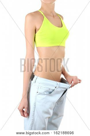 Dieting concept. Woman wearing big trousers isolated on white