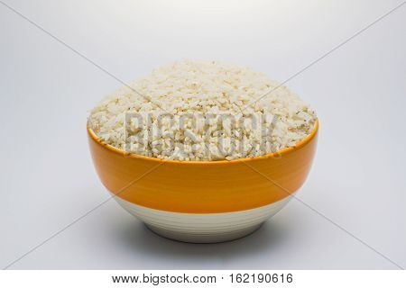 Rice be imperfect in the bowl on white background.