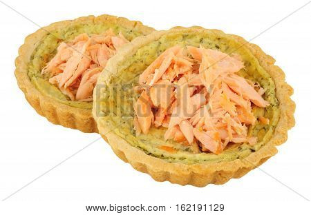 Hot smoked salmon and watercress tarts isolated on a white background