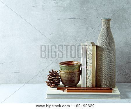 An arrangement of rustic ceramic decorations with envelopes and a gift box