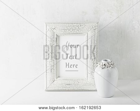 Simple still life with a shabby chick picture frame and a vase