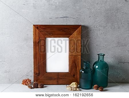 Rustic frame mock up with dried plants and glass bottles
