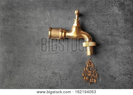 Water shortage concept. Tap with rust on grey background
