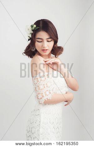 Beautiful Asian Woman Bride On Grey Background