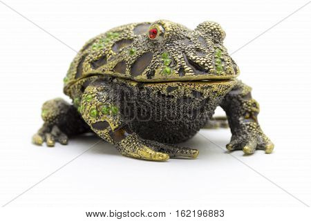 Statuette of a frog close up on a white background.
