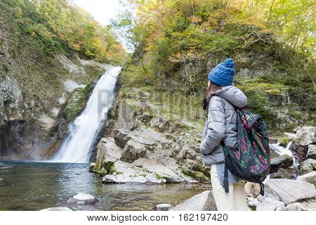 Woman go for hiking in waterfalls