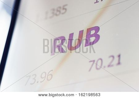 finance, currency and money concept - digital display with ruble exchange rate on screen