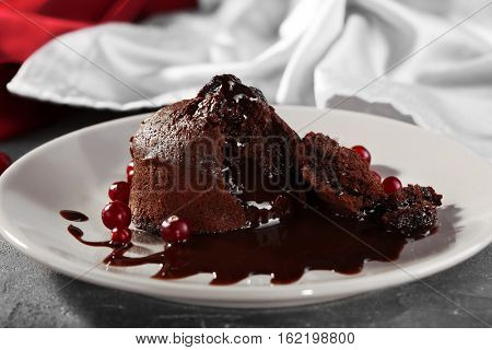 Chocolate fondant with berries on plate