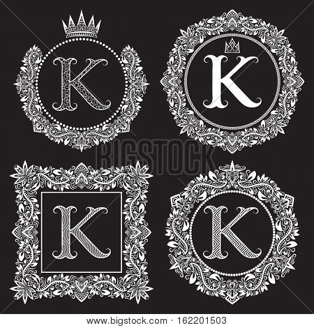 Vintage monograms set of K letter. Heraldic coats of arms in wreaths round and square frames. White symbols on black.