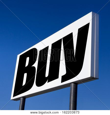 Horizontal billboard with the order to BUY against real blue sky. Abstract concept of consumerism human mind control power of corporations and lobbies.