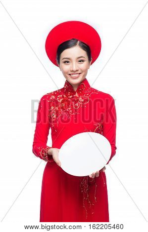 Portrait Of A Beautiful Asian Woman On Traditional Festival Costume Ao Dai Holding A Dish. Tet Holid