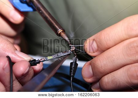 Use Soldering Iron To Weld Connection Pore With Tin Wire.