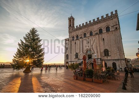 GUBBIO, ITALY - DECEMBER 18, 2016: Beautiful square of Gubbio at sunset with christmas tree
