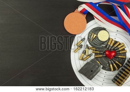 Concept of shooting competitions. Sport shooting. Biathlon background diploma. Tools and targets on wooden background. Caliber ,22