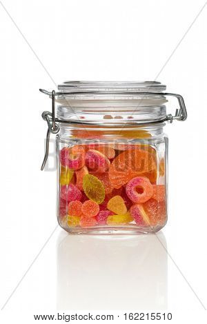 Candy jar on white background. Jar filled with brightly colored sweets (fruity jelly sweets).