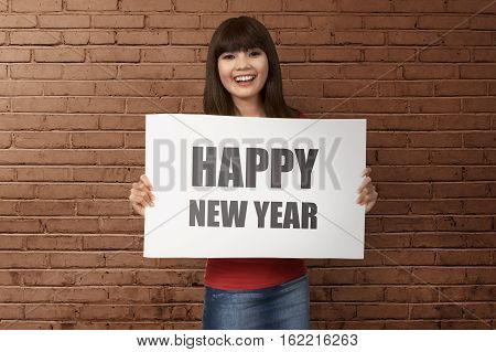 Happy Asian Woman Holding Happy New Year's Greeting