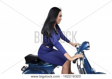 Asian Young And Beautiful Woman Riding Scooter