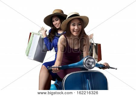 Smiling Two Young Asian Woman Riding The Scooter With Shopping Bag