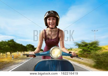 Attractive Asian Woman Riding A Blue Scooter
