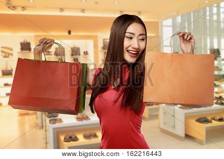 Chinese Woman In Cheongsam Dress Carrying Shopping Bag