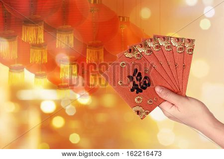Person Hand Holding Some Red Envelope
