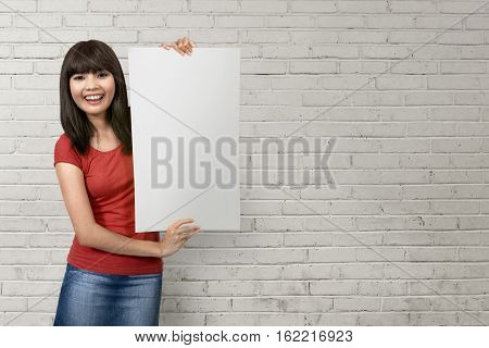 Cheerful Young Asian Woman Holding A White Blank Paper