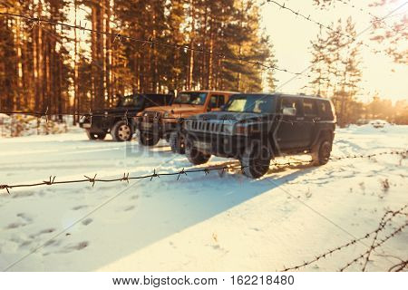 Karelia, Russia, 10 Dec 2016 check out the Jeep Wrangler club on lake Ladoga, the Jeep Wrangler is a compact four wheel drive off road and sport utility vehicle
