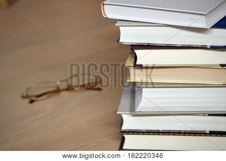 Stack of books and glasses on the floor