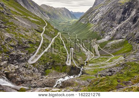 Norwegian mountain road. Trollstigen. Stigfossen waterfall. Norway tourist landscape valley. Horizontal