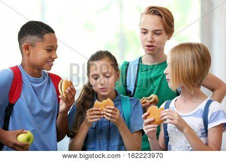Cute kids eating in school