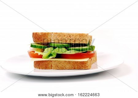 Healthy ham sandwich with cheese tomatoes on white background