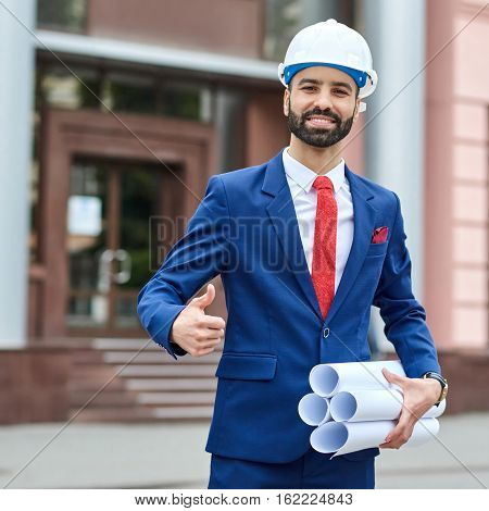 Cheerful Professional Architect Showing Thumbs Up