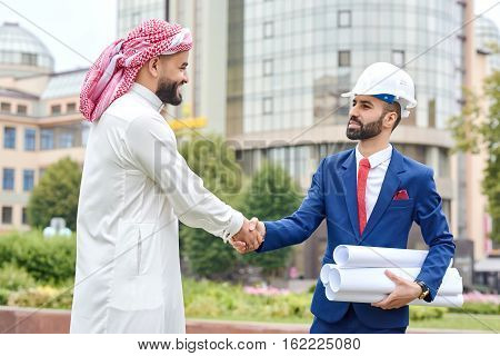 Professional Engineer Shaking Hands With His Client