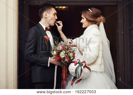 Bride Give A Fiance A Chocolate In The Front Of The Church's Door