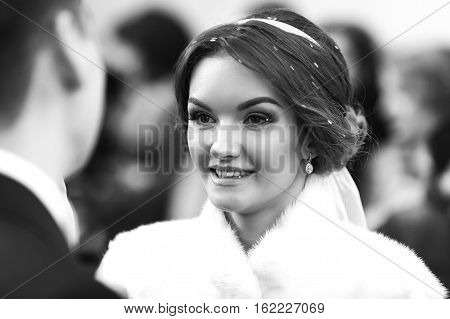 Bride Smiles While Looking At The Fiance