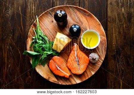 Raw humpback salmon steaks, cheese, rustic wooden background, above view. Fillet with fresh ingredients for tasty cooking and frying pan. Top view. Healthy and diet food concept.
