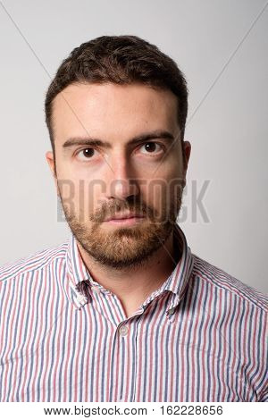 Man Close-up Face Portrait Isolated On Gray Background