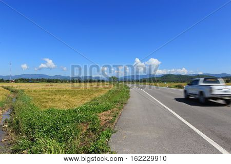 Moving truck on the lane blue sky background in Chiang rai Thailand