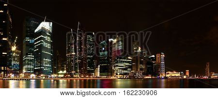 A view of Singapore by night taken from marina bay sands.