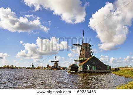 Ancient windmils near Kinderdijk, Netherlands in sunny day