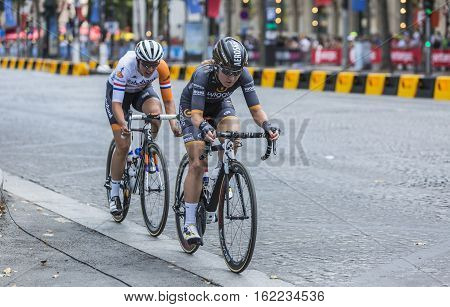Paris France - July 24 2016: Two female cyclists Amy Pieters of Wiggle High5 Team and Lucinda Brand of Raboliv Women Cycling Team riding on Champs Elysees in Paris during the second edition of La Course by Le Tour de France 2016.
