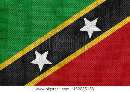 Flag Of Saint Kitts Und Nevis On Old Linen
