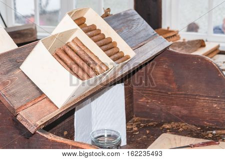 Traditional manufacture of cigars in an old tobacco factory in Havana in Cuba.